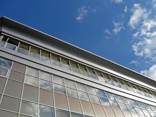 new urban glass reflective building, blue sky