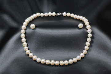 White pearl necklace with pearl earrings