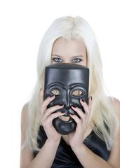 blond girl hiding behind black mask