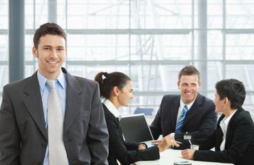 Happy businessman on meeting