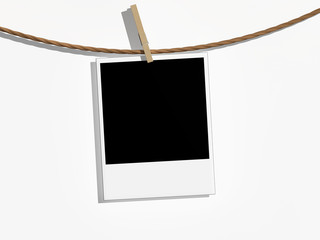 Polaroid hängt an Leine