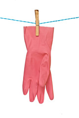 red glove drying on rope