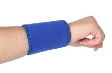 Human hand with a wrist brace, orthopeadic equipment over white