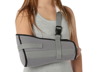 Woman wearing an arm brace over white