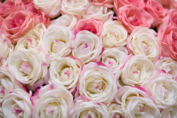 Big bunch of multiple pink roses of a bride on a wedding.