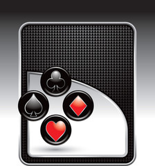 Playing card suits on black checkered background