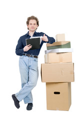 young man standing near the pile of boxes