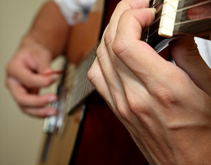 Guitar and hands of the guitarist  close up