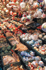 Painted christmas balls and tree decorations sold on the market