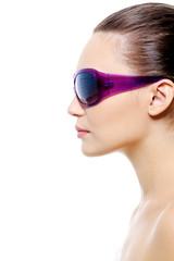 Profile portrait of  female face in violet sunglasses
