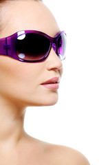 Female fashion model in purple sunglasses