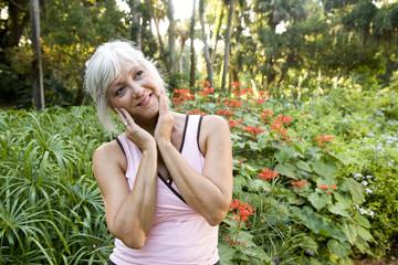 Mature woman enjoying park foliage
