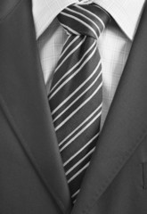 Detail of a Business man Suit with black tie
