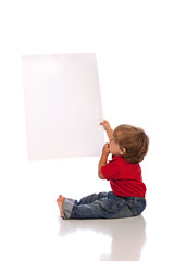 baby boy holding blank paper