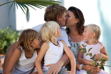 very happy family outdoors