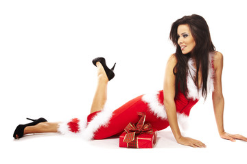 Woman wearing santa claus and holding red gift on white backgrou