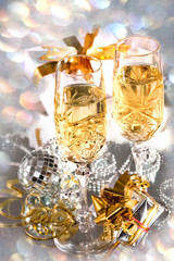 Crystal Glasses with champagne and gifts in festive packaging