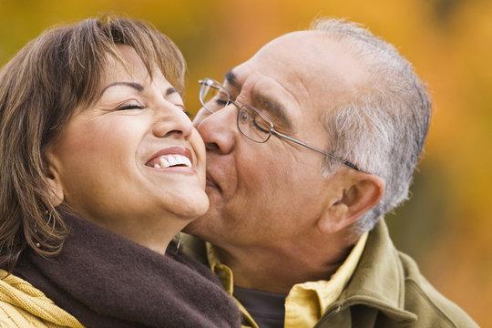 Hispanic couple kissing outdoors