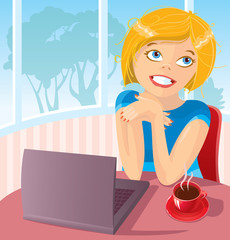 The young woman works behind the laptop with a coffee cup