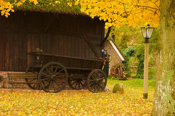 A barn in autumn landscape village