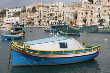 Luzzu fishing vessels in Kalkara Creek Malta