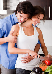 Romantic couple enjoying their love in kitchen