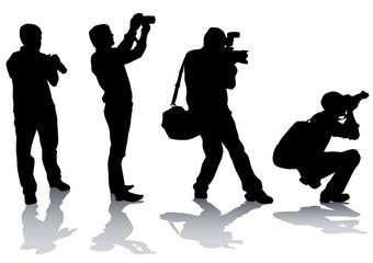 Photographer mans