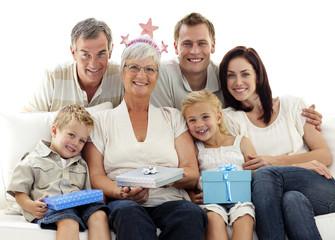 Family celebrating grandmother's birthday