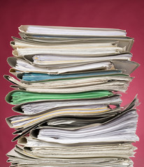 Finance documents on red background