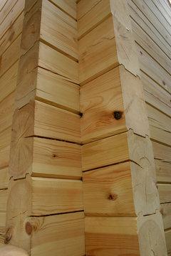Corner of planed pine log house