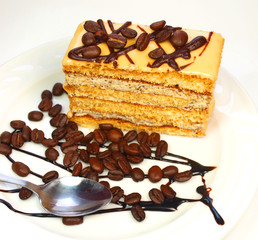 Coffee cake with coffee beans and chocolate isolated on white