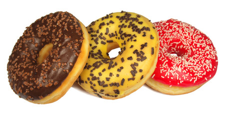 Three colored donuts isolated on white
