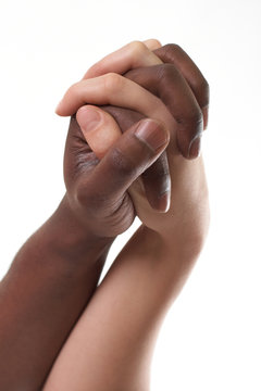 black and white couple holding hands