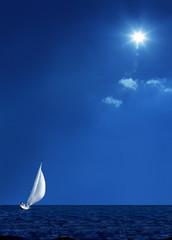Spoed Foto op Canvas Zeilen Sailing boat on the sea and blue sky
