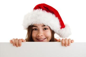Girl in Santa's hat holding empty board