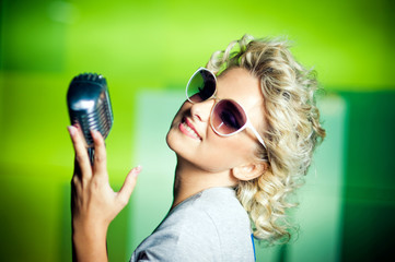 Young singer with retro sunglasses