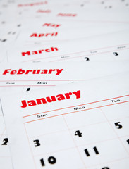 stack of monthly calendars
