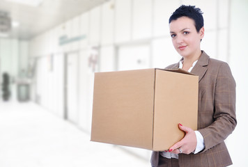 Young sexy attractive woman with box in hands