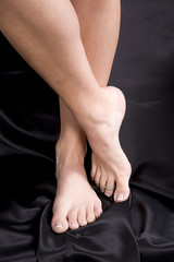 Feet crossed on black