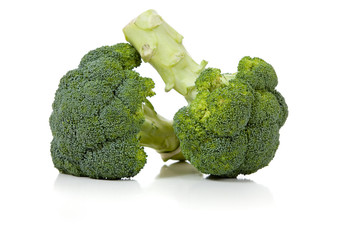 Two broccoli florets on white