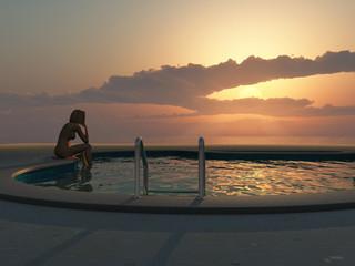woman sitting on beach swimming pool