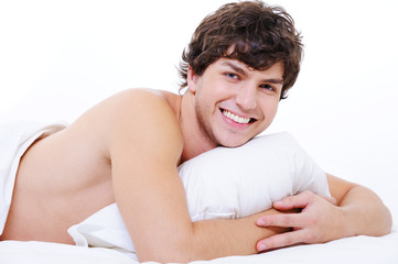 happy smiling man in bed