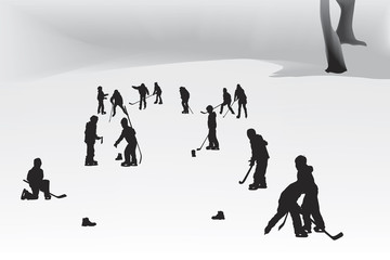 children playing hockey on a frozen lake