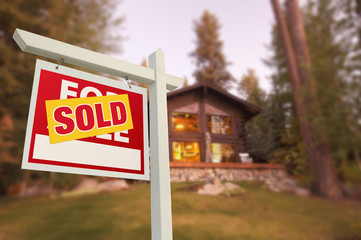 Sold Home For Sale Sign and Beautiful Log Cabin
