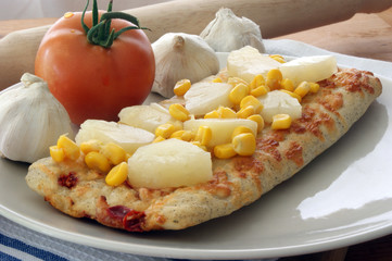 stone oven baked pizza with corn, tomato and garlic