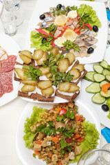 table with appetizers and black bread sandwiches with lard