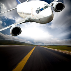 the airplane with the blue sky background. - fototapety na wymiar