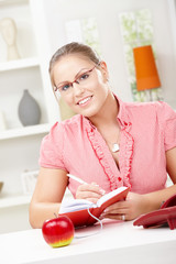 Young woman writing diary