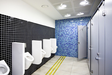 Public toilet with cubicles and urinals
