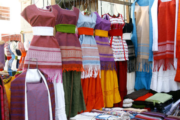 Indigenous handmade Mexican dresses in Oaxaca market, Mexico